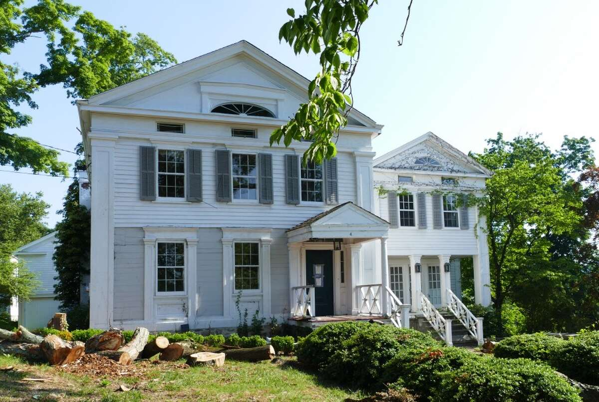 The once dignified looking building at 4 Main Street, has been purchased by Arnold Karp who plans to give it some TLC. Progress has already been made, by clearing out trees and ridding the house of uninvited guests such as raccoons. - Grace Duffield photo