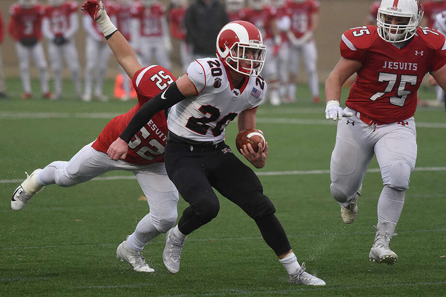 New Canaan senior co-captain Quintin O'Connell in action during the Class LL semifinals on Sunday. O'Connell has 25 receptions for 248 yards in two playoff games so far. — Dave Stewart photo