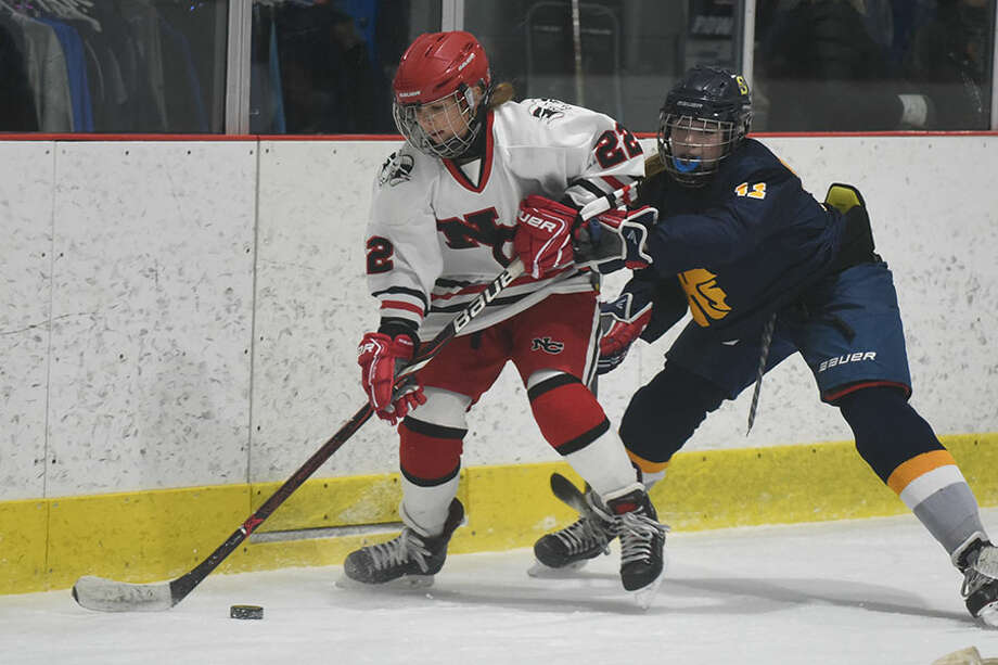 New Canaan freshman Grace Crowell, works along the boards during the Rams' win over Simsbury on Tuesday, Dec. 11, at the Darien Ice House. — Dave Stewart photo