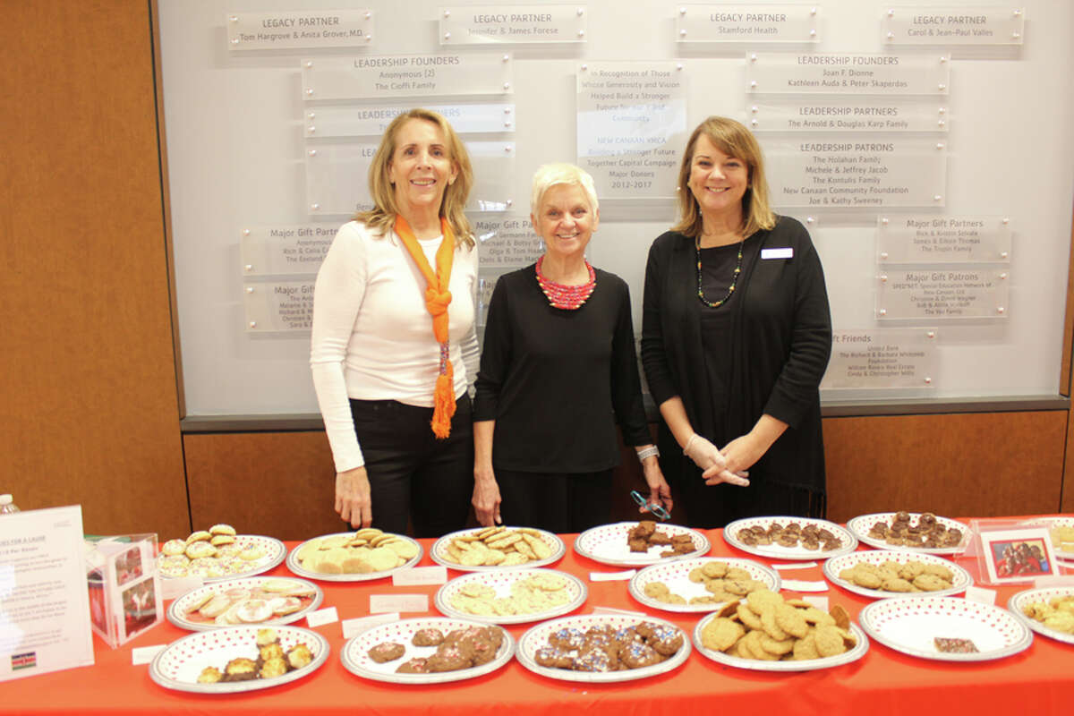 The New Canaan YMCA's recent holiday bazaar helped children in Kenya. New Canaan YMCA staff members, from left, Anne Goebel, Mary Coleman, and Diana Riolo, staff a table of baked goods, among items sold at a recent holiday bazaar to raise money for Facing the Future, a child development facility in Kibera, Kenya. - Contributed Photo
