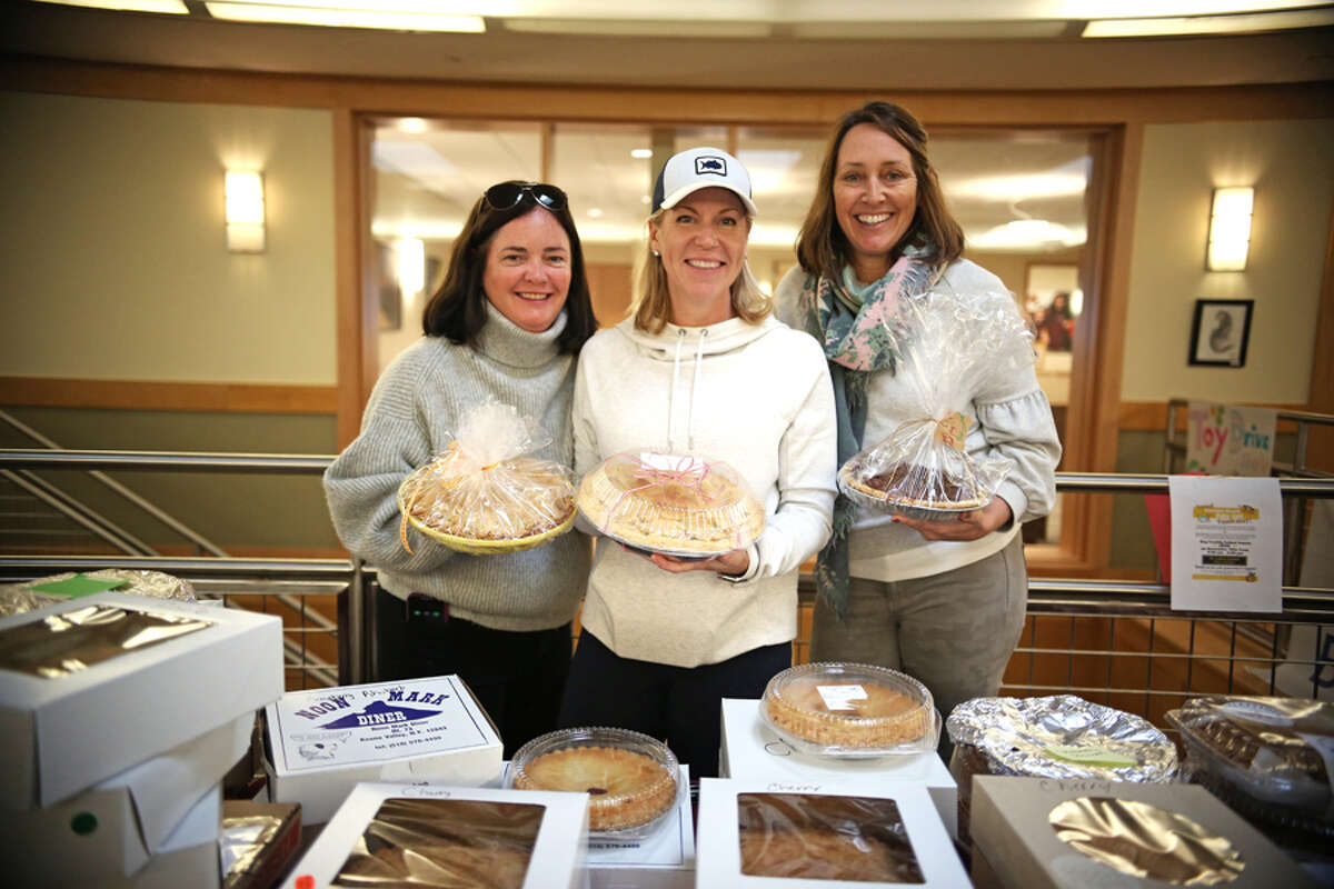 A pie giveaway recently sweetened Thanksgiving at St. Luke's in New Canaan. St. Luke's parents Kate Stimpson of New Canaan, left, Jen Kubick of Ridgefield, center, and Alicia Lyon of Darien, not in the photograph,  headed up St. Luke's annual Parents' Association Faculty & Staff Pie Giveaway. Penelope Jones of New Canaan, right, along with many St. Luke's families donated more than 200 pies distributed to the school's faculty and staff. - Photo by Valerie Parker