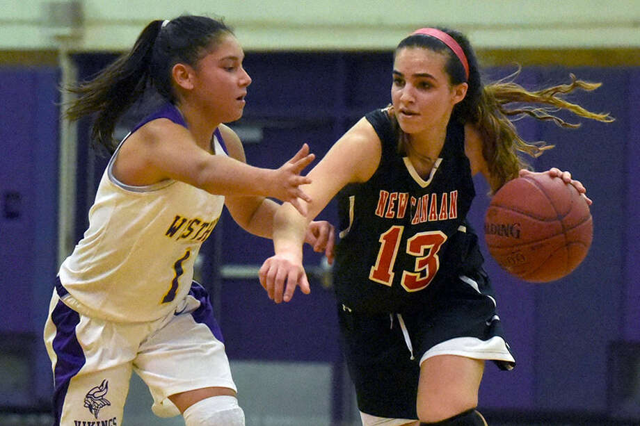 New Canaan's Emily Shizari drives to the hoop during a game last winter. Shizari, Caitlin Blair, Catherine Bopp, and Emily Bryant are the Rams' senior co-captains this season. — Dave Stewart photo