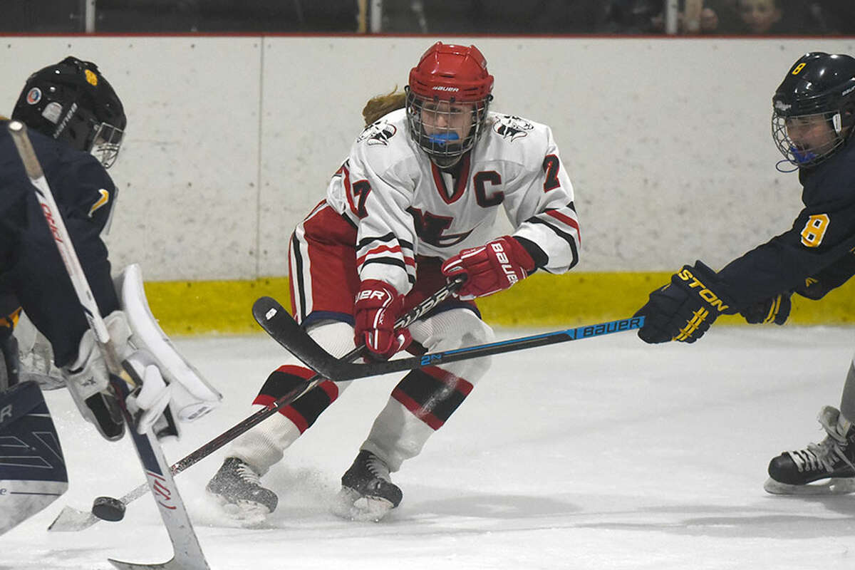 New Canaan's Jess Eccleston sends a shot at Simsbury goalie Tori LaCroix during the Rams' 3-1 win on Tues., Dec. 11, at the Darien Ice House. - Dave Stewart photo