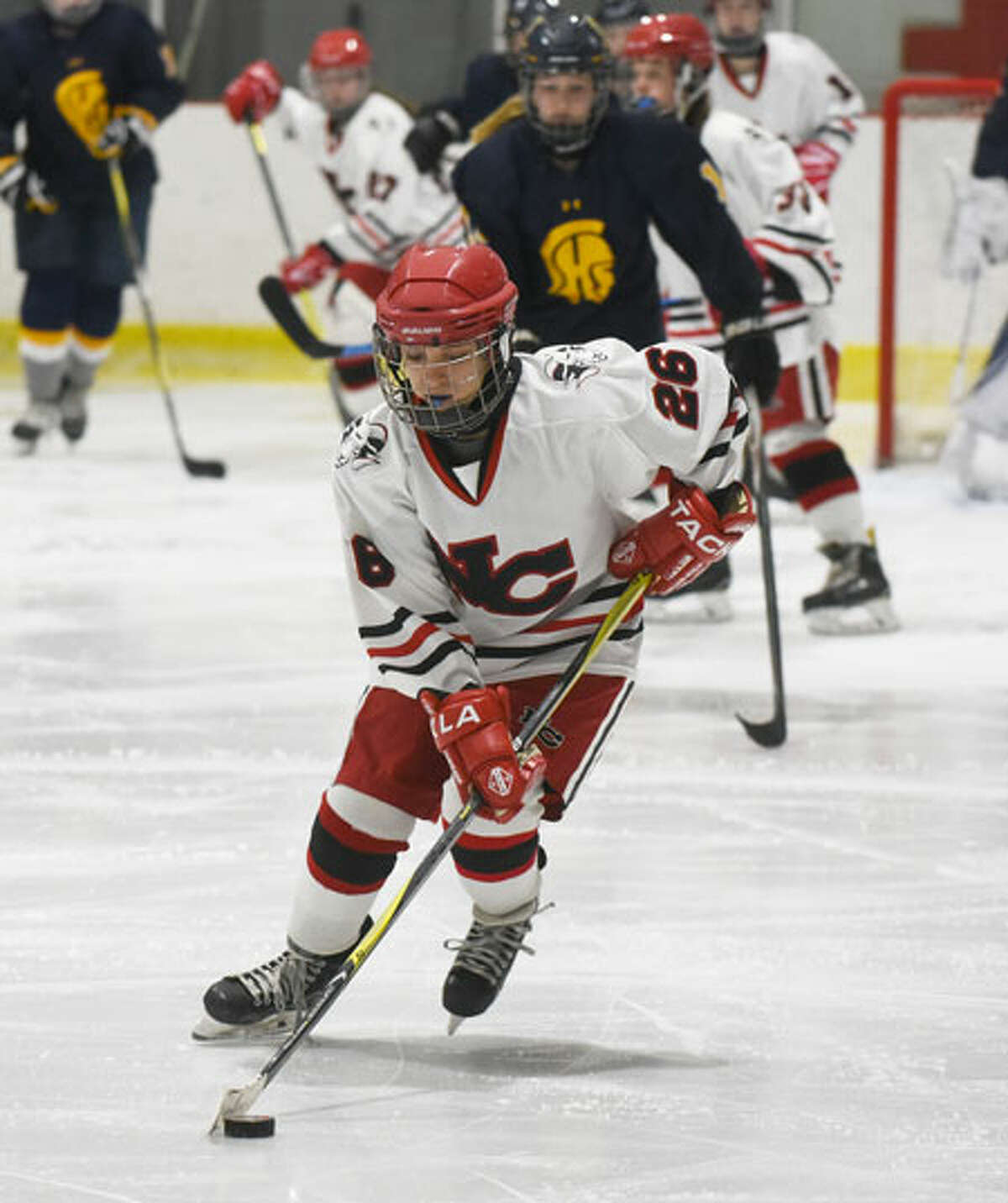 New Canaan's Sophie Potter controls the puck in the offensive zone. - Dave Stewart photo
