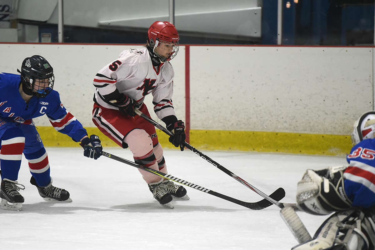 New Canaan's Anika Curri (5) gets a shot on net during the first period of the Rams' 7-0 win over Fairfield Tuesday night at the Darien Ice Rink. - Dave Stewart photo