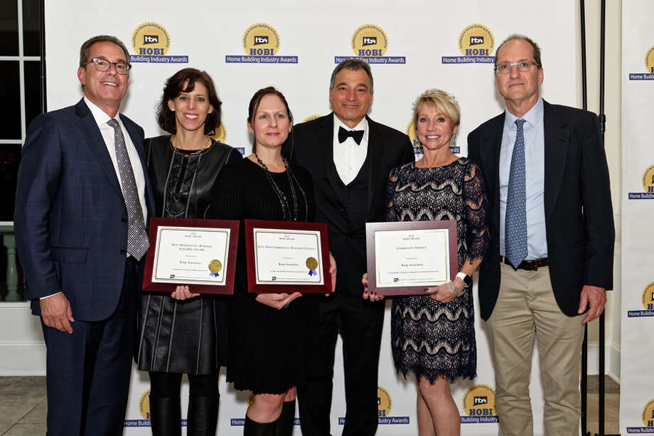 Karp Associates of New Canaan received four more HOBI Awards this year, bringing its two-decade total to 43. From left are Arnold Karp, Robin Carroll and Michelle Sirois of Karp Associates; Home Builders and Remodelers Association President Peter Fusaro; and Penee Weicker and Paul Stone of Karp Associates.