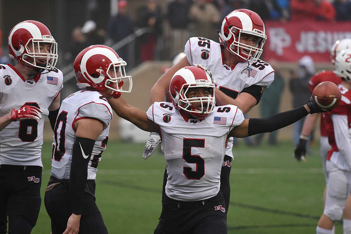New Canaan senior RB JR Moore (5) celebrates a touchdown with Harrison Skyrm (55), Quintin O'Connell (20) and Wyatt Wilson (6) during the second half of the Rams' 38-7 win over Prep in the Class LL semis on Sunday. - Dave Stewart photo
