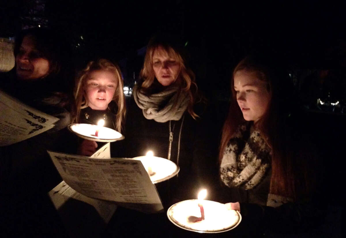 Caption: Christmas caroling on God's Acre in New Canaan on Christmas Eve, Tuesday, Dec. 24, 2013. - Abby Hersam photo