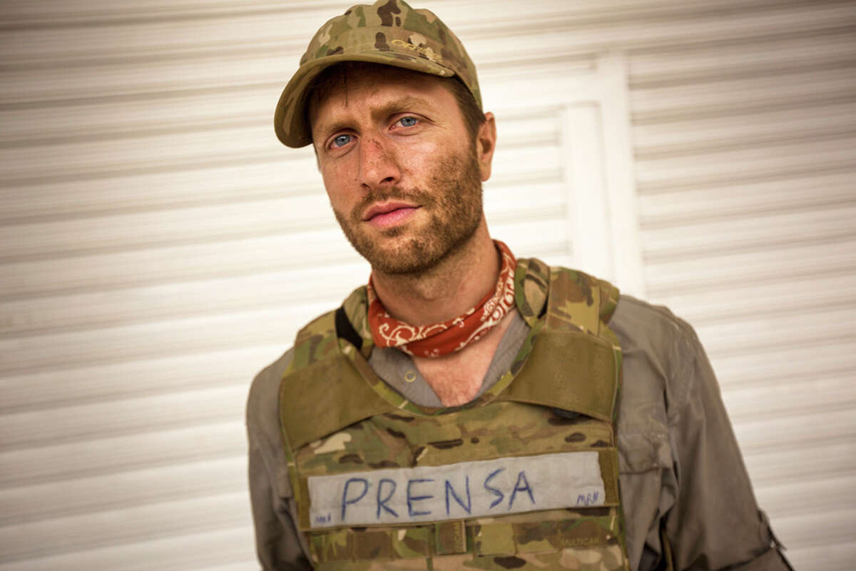 """New Canaan Country School alum Matthew Heineman's film, """"A Private War"""" is now in theaters. New Canaan Country School graduate Matthew Heineman is the director and producer of a new film, """"A Private War"""" which is now in theaters. He is shown on location while shooting his last movie, """"Cartel Land"""" in Mexico. - Contributed photo"""
