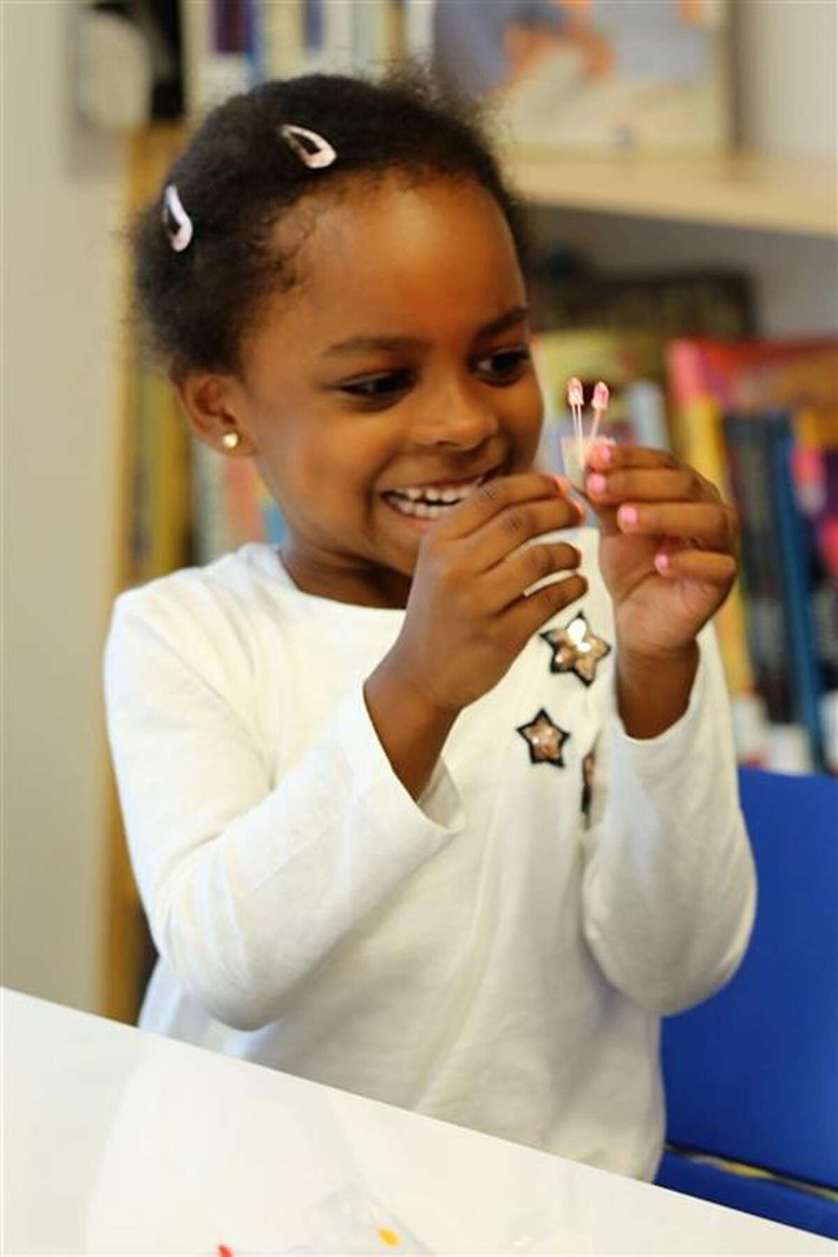 The reopening of the New Canaan Country School's Library has sparked creativity. Kindergartners experiment with LED lights in Country School library's new addition of the Amicus Foundation Innovation Space. - Contributed photo
