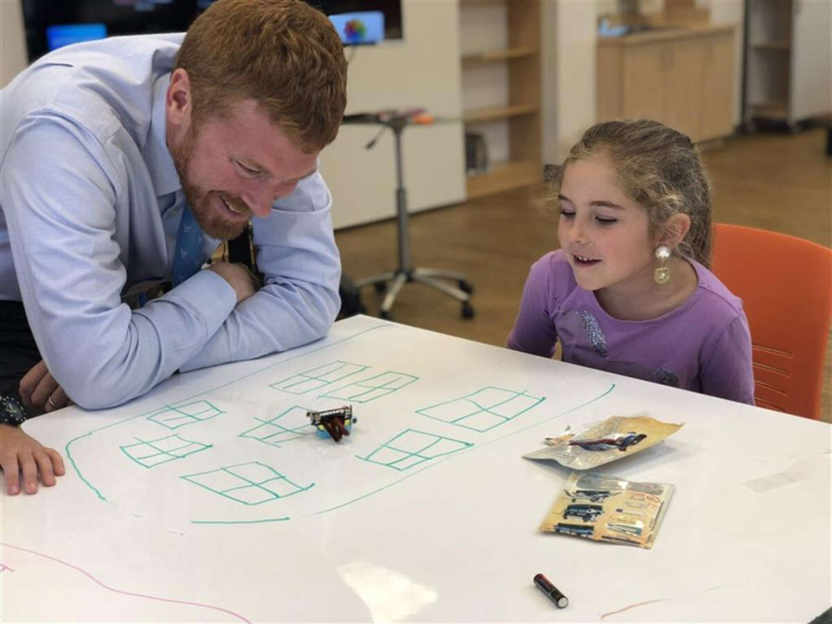 """Head of School Aaron Cooper stopped in to watch as first graders experimented with robotics, building their own motorized """"bristlebots"""" in Country School library's new addition of the Amicus Foundation Innovation Space. - Contributed photo"""