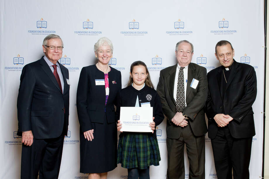 "A St. Aloysius fifth grader has received the ""Leader"" scholarship. St. Aloysius School fifth grader Maya Ruszczyk recently received a Leaders of Tomorrow scholarship at the program's second annual breakfast reception at Catholic Center in Bridgeport. Maya (center) is joined by, from left, Thomas E. McInerney, Holly Doherty-Lemoine, St. Aloysius School Principal Dr. John Alfone, and the Most Rev. Frank J. Caggiano, Bishop of the Diocese of Bridgeport. — Contributed photo / AMY MORTENSEN"