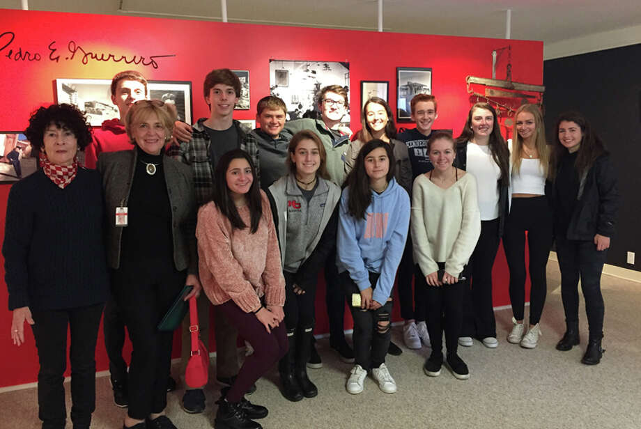 New Canaan High School students visited the Pedro E. Guerrero exhibition Nov. 13 at the New Canaan Historical Society. Pedro was the Photographer of Mid-Century New Canaan. His daughter Susan Guerrero gave the students a first-hand commentary. Front row, from left, Susan Guerrero; teacher Jeanne McDonagh; students, Caroline Tuffy, Liza Cuoco, Demetria Dresser, and Ava Nichols; back row: Stephen Rivas, Reid Dahill, Timothy Hardy, Peter Harvey, Caroline McLaughlin, Andrew Jameson, Sarah Murphy, Brooke Barber and Morgan Hibbert. — Contributed photo