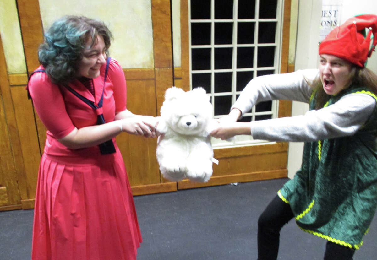 The New Canaan Town Players are going to open The Christmas Toy shop for two weekends starting this coming Friday, Nov. 30, 2018. Nix the Elf tries to save a teddy bear from the whining Wilhelmina Wellington. (l-r. Ava Sabloff, Fiona Stevens) - Cindy Ording photo