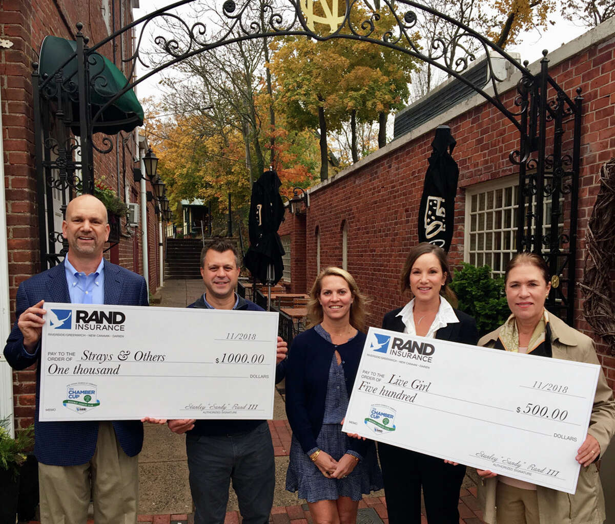 New Canaan: Rand Insurance has donated prize money from the New Canaan Chamber of Commerce's annual golf event for non profits. Shown with checks, from left, Nicholas