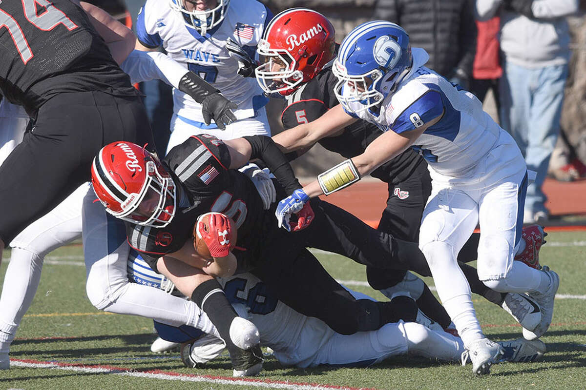 New Canaan's Christian Sweeney dives into the end zone for a touchdown during the Turkey Bowl in Stamford on Thanksgiving. - Dave Stewart photo