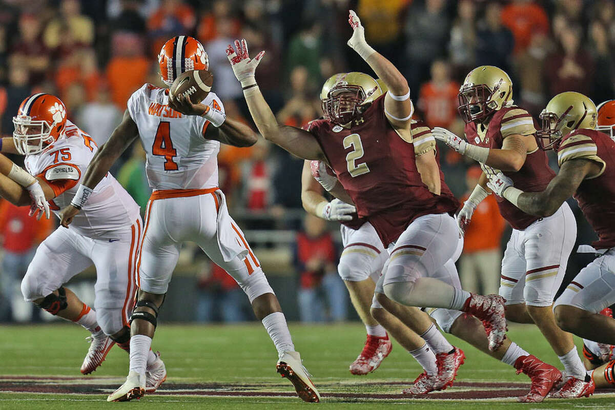 New Canaan's Zach Allen, a senior at Boston College, pressures former Clemson QB Deshaun Watson - Boston College Athletics photo