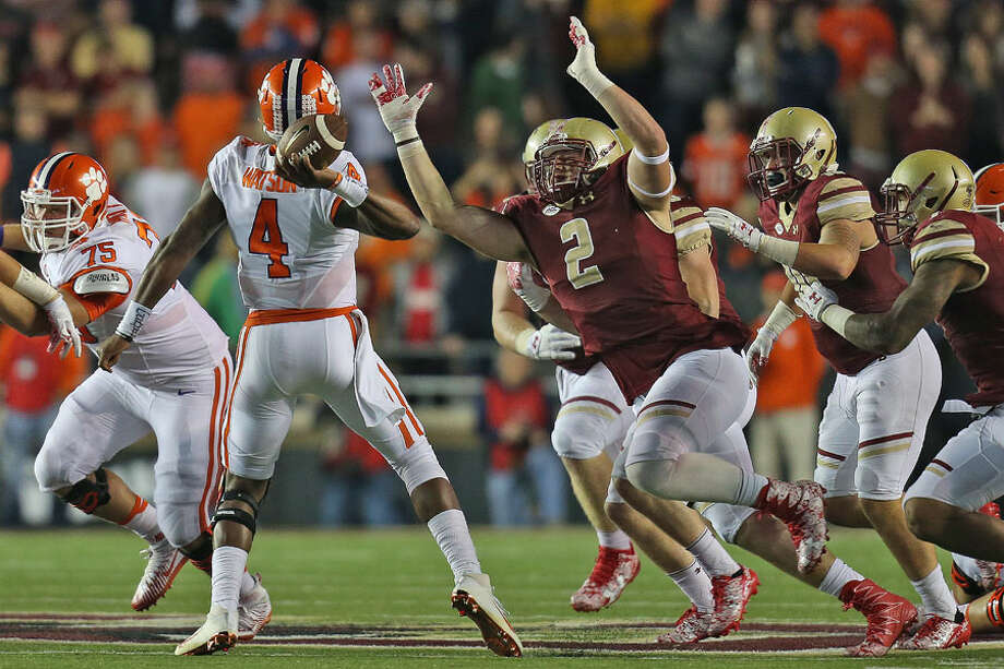New Canaan's Zach Allen, a senior at Boston College, pressures former Clemson QB Deshaun Watson — Boston College Athletics photo