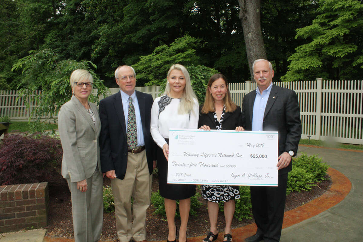 The Waveny LifeCare Network in New Canaan has announced its financial assistance program, with the First County Bank Foundation pledging support first. From left, Karen Kelly, vice president, First County Bank Foundation; Tom Ferguson, chairman, Board of Directors of Waveny LifeCare Network; Agnieszka Maciejewski, assistant vice president and branch manager, First County Bank; Cynthia Gorey, vice president of Development at Waveny; Rey Giallongo, chairman and CEO of First County Bank and president, First County Bank Foundation. - Contributed photo
