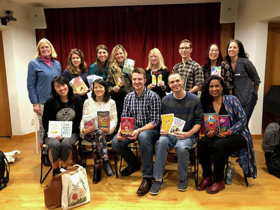 "Young readers recently met authors at an ""Extravaganza."" From left, back row: Melissa Thorkilsen, Elm Street Books, authors Rebecca Behrens, Alyson Gerber, Jodi Kendall, Jennifer Roy, Eliot Schrefer, Debbi Michiko Florence, and Cheryl Capitani, manager of Services to Families, New Canaan Library; from left, front row: authors Kat Yeh, Karina Yan Glaser, Adam Perry, Jake Burt, and Sayantani Dasgupta. — Contributed photo"