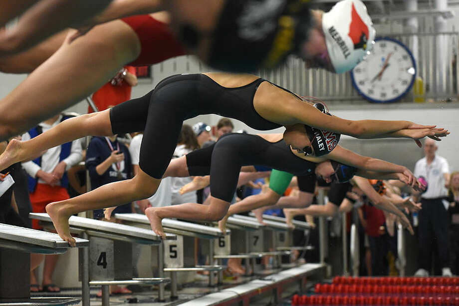 New Canaan's Maddie Haley at the start of a race during last year's FCIAC swimming finals at Greenwich HS. — Dave Stewart photo
