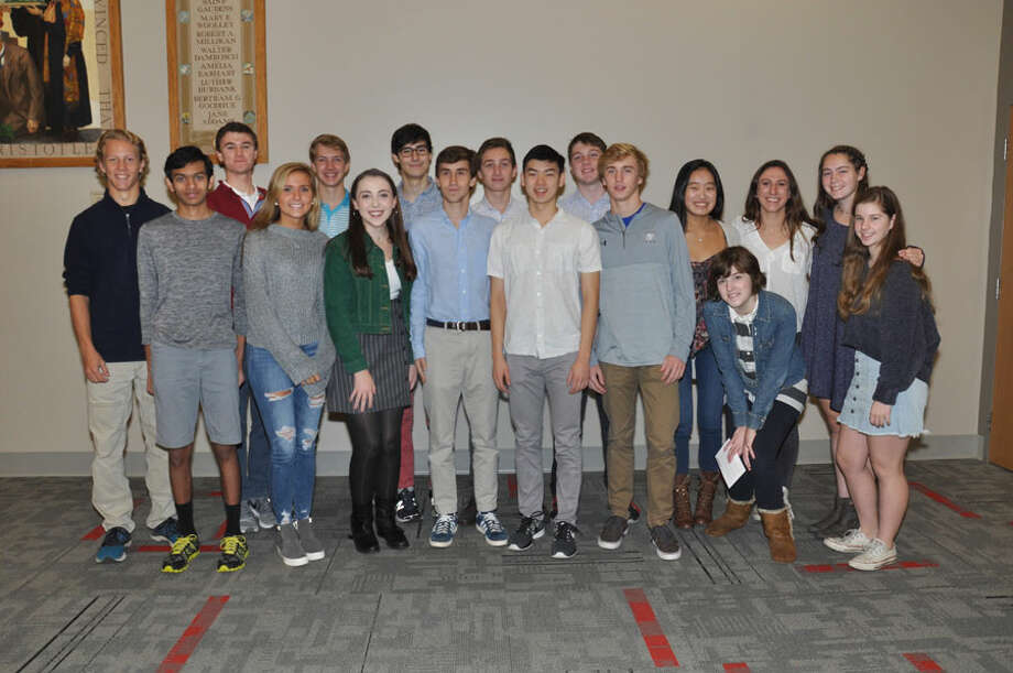 Twenty-one New Canaan High School students have been named Merit Scholars. New Canaan High School's 2018 Merit Scholars, from left, Max Plum, Lance Phillips, Kevin Brunner, Natasha Tchir, Dylan Shane, Erin Spiess, Victor Alvarez, Oliver Crookenden, Gray Farley, Daniel Lu, Conor West, Luke Crowley, Bridget Haley, Katelyn Robertson (in front, crouching), Nicole Vanderlee, Katherine Reeves, and Katherine Unger. Merit Scholars Griffin Fill,  Elizabeth Greer, Meghan Kloud and William Rechtermann are not in the photo. — Photo by Valerie Stryker