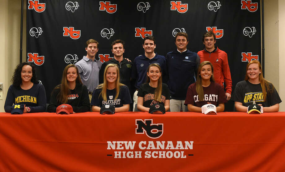 Eleven New Canaan athletes signed their National Letters of Intent to play sports in college on Wednesday at NCHS. From left, front row, Caitlin Esse (Michigan, Crew), Kendall Patten (Cornell, Soccer), Campbell Connors (Butler, Lacrosse) Claire Ross (Boston College, Diving), Lauren Bisceglia (Colgate, Lacrosse), and Meghan Mitchell (Appalachian State, Golf); back row, Matthew Cosco (Furman, Lacrosse), Tim Norton (Vermont, Lacrosse), George Dumbauld (Drexel, Lacrosse), Quintin O'Connell (North Carolina, Lacrosse), and Walker Ker (Boston University, Lacrosse). — Dave Stewart photo