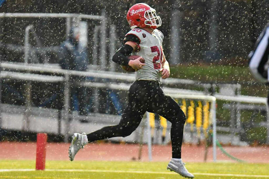 New Canaan senior co-captain Quintin O'Connell scores one of his 3 touchdowns during the Rams' 41-7 win over Ludlowe on Friday, Nov. 9. — Gregory Vasil/Hearst Connecticut Media photo
