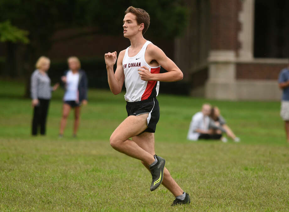 New Canaan senior co-captain Andrew Malling, shown in action during a cross country meet in Waveny Park, was second at the Winding Trails Invitational, held Saturday in Farmington. — Dave Stewart photo