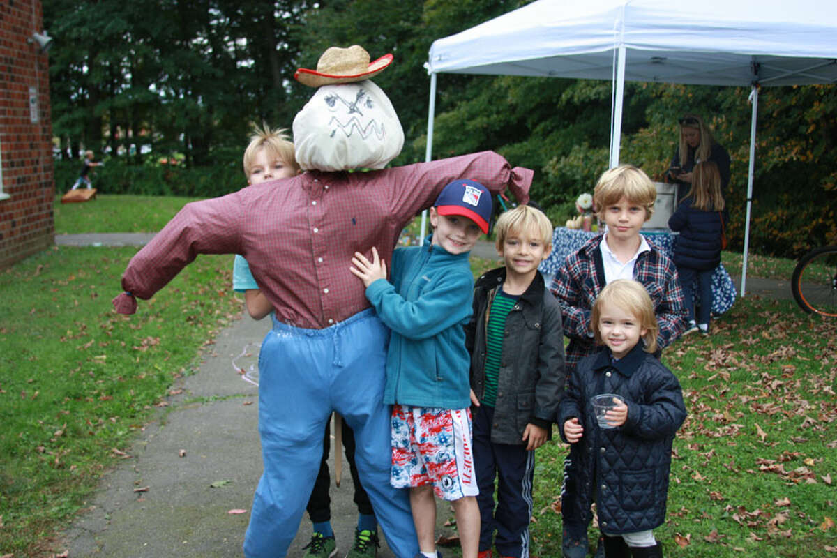 Students take part in a scarecrow stuffing activity. - Contributed photo