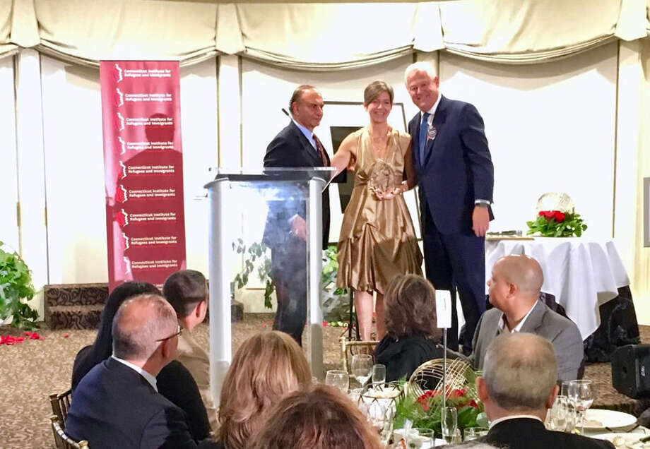 New Canaan: Immigrants were recently honored. Pictured are: Farooq Kathwari, Claudia Connor and Jack Leslie.