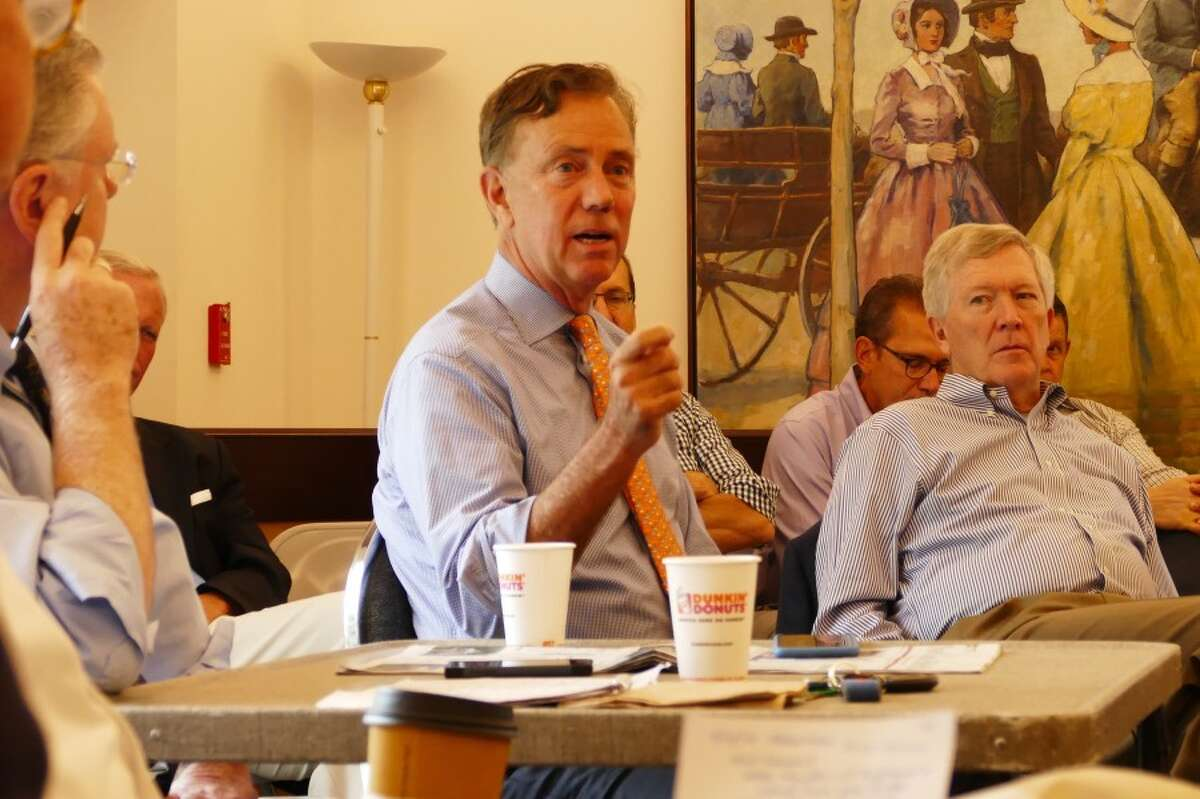 Democrat Ned Lamont talks as Republican First Selectman Kevin Moynihan looks on skeptically. - Grace Duffield photo