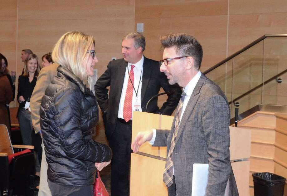 Dr. Marc Brackett, founding director of the Yale Center for Emotional Intelligence, right, speaking with a parent after his presentation in the Saxe auditorium. New Canaan Superintendent of Schools Dr. Bryan Luizzi, seen here in the center, was in a separate conversation. — Greg Reilly photo
