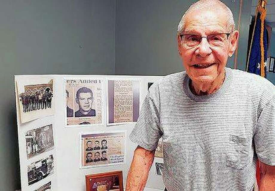 Robert Redfern of Galesburg was surprised by friends, family and firefighters in celebration of his 95th birthday. Redfern was a firefighter from 1955 to 1979 and helped battle some of the city's big fires. Photo: Talbot Fisher | Register-Mail (AP)