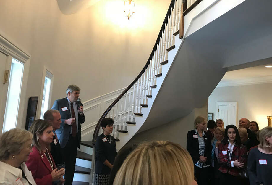 Bob Stefanowski, with his wife Amy in front of him, speaks to a group of mostly women at the Williams residence on Oct. 22. — Contributed photo