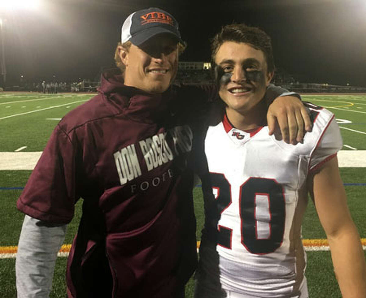 Former Ram Kevin Macari with current New Canaan senior co-captain Quintin O'Connell. O'Connell notched his 31st TD reception on Thursday, breaking Macari's old program record of 30.