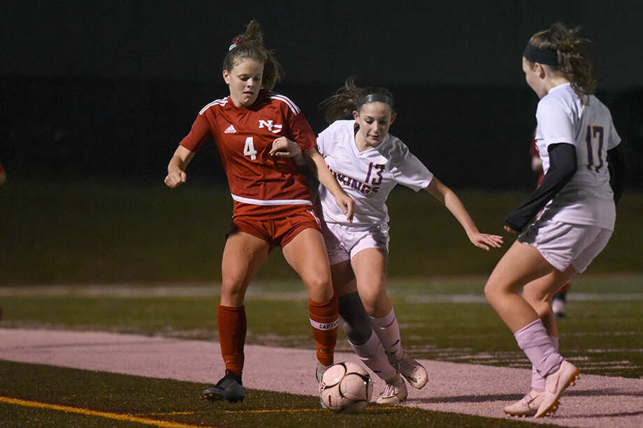 New Canaan's Kendall Patten (4) battles Westhill's Katelyn Benner for the ball during Monday's girls soccer game at Dunning Field. — Dave Stewart photo