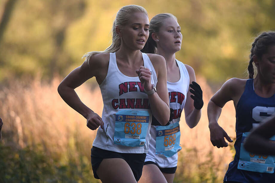 New Canaan's Elaina Tiller and Sophie Curcio led the Rams at the FCIAC girls cross country championship race Thursday in Waveny Park. — Dave Stewart photo