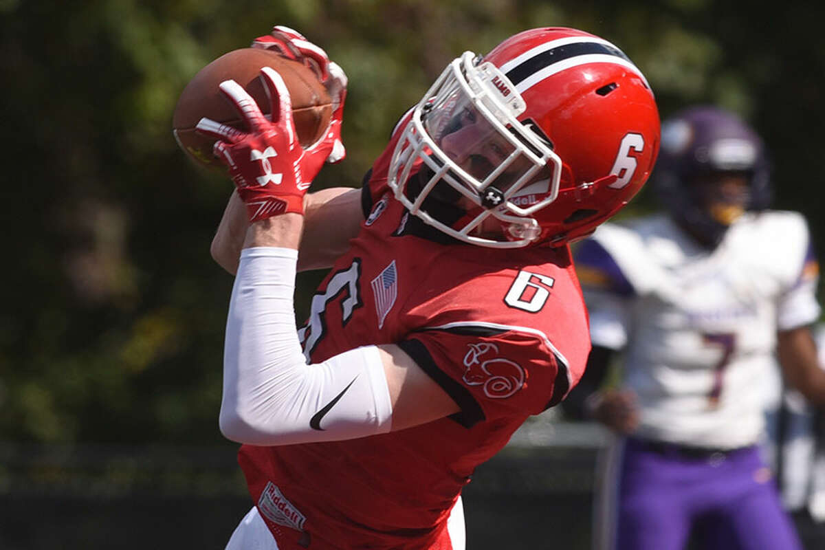 Wyatt Wilson, shown in action during the Rams' Homecoming game, was one of five New Canaan receivers with touchdowns during Friday's win at Trinity Catholic. - Dave Stewart photo