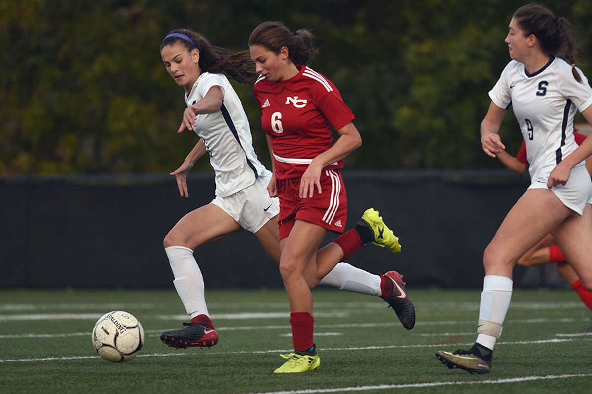 New Canaan's Kaleigh Harden races through the midfield during Friday's loss to Staples at Dunning Field. - Dave Stewart photo