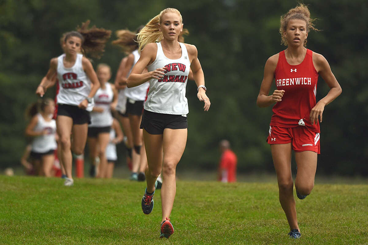 New Canaan senior co-captain Elaina Tiller and Greenwich's Zoe Harris go stride for stride during Monday's cross country meet in Waveny Park. - Dave Stewart photo