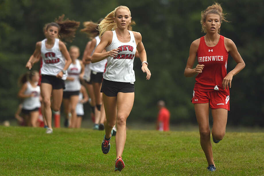 New Canaan senior co-captain Elaina Tiller and Greenwich's Zoe Harris go stride for stride during Monday's cross country meet in Waveny Park. — Dave Stewart photo