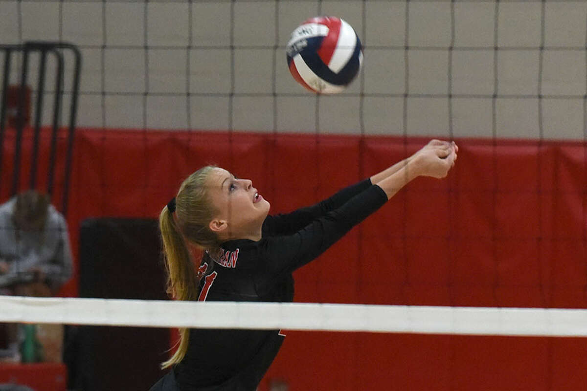 New Canaan senior co-captain Emma Wheeler keeps the ball alive during a recent match at NCHS. - Dave Stewart photo