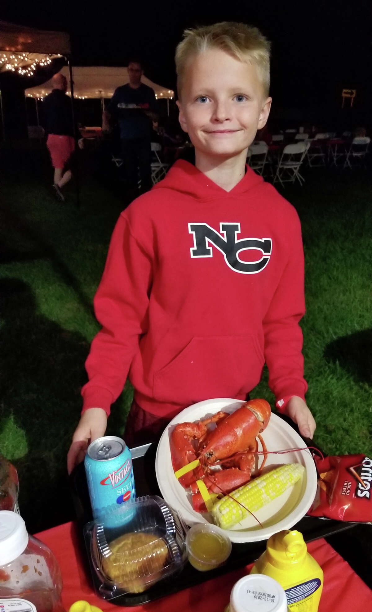 About to enjoy his lobster dinner, this youngster was very happy, was all smiles.