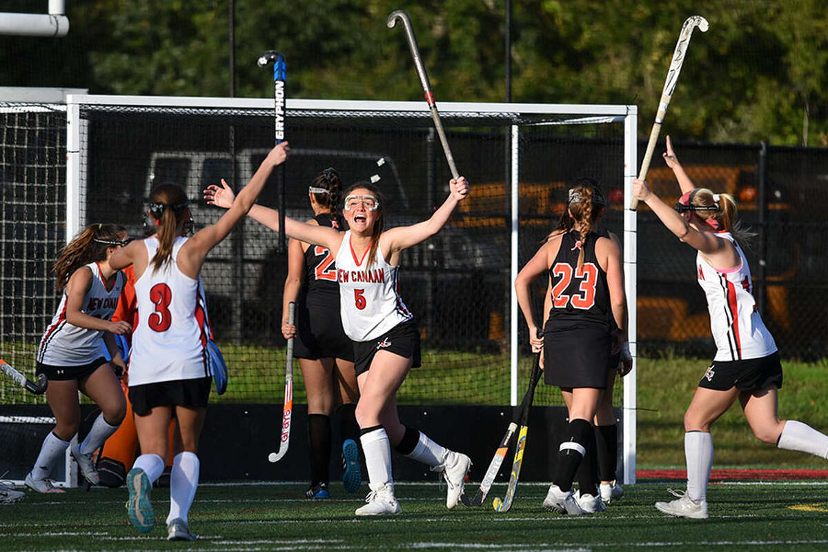 New Canaan senior Lily Farriss celebrates after scoring a goal in the second half of the Rams' 3-0 win over Stamford on Tuesday. - Dave Stewart photo