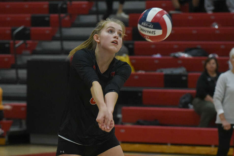 New Canaan senior Josie Matyszewski keeps the ball in play during the Rams' match against Darien on Monday in the NCHS gym. — Dave Stewart photo