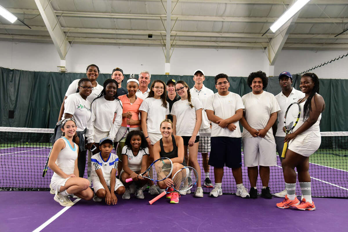 The New Canaan Racquet Club recently showcased its new surfaces. Members of the Norwalk and Stamford Grassroots Tennis Organizations at the New Canaan Racquet Club open house on Sept. 30. - Contributed photo