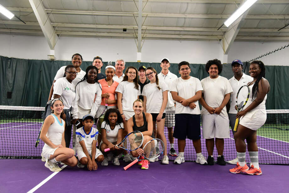 The New Canaan Racquet Club recently showcased its new surfaces. Members of the Norwalk and Stamford Grassroots Tennis Organizations at the New Canaan Racquet Club open house on Sept. 30. — Contributed photo