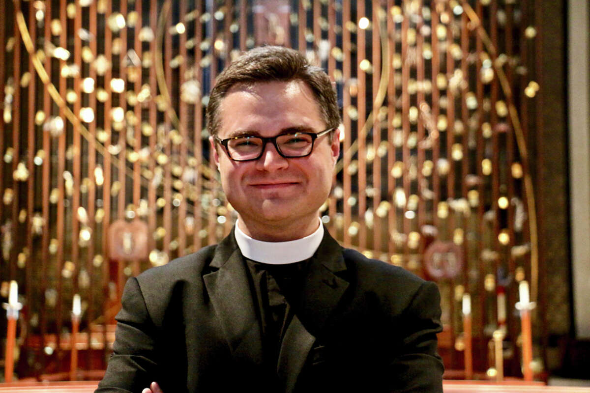 The Rev. Justin E. Crisp takes a new role in the parish as associate rector and theologian-in-residence. - Contributed photo