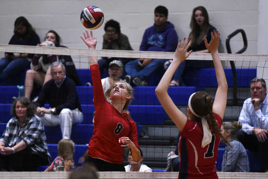 New Canaan's Josie Matyszewski sends a shot back at the Brien McMahon Senators during a volleyball match on Oct. 12. — Dave Stewart photo